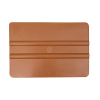 Soft golden plastic squeegee